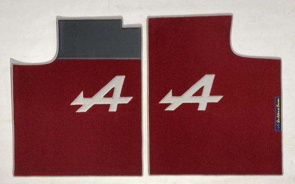 Renault Alpine A310 pair on carpet on grey red carpet