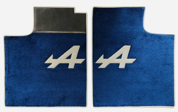 Renault Alpine A310 pair on carpet on white blue carpet