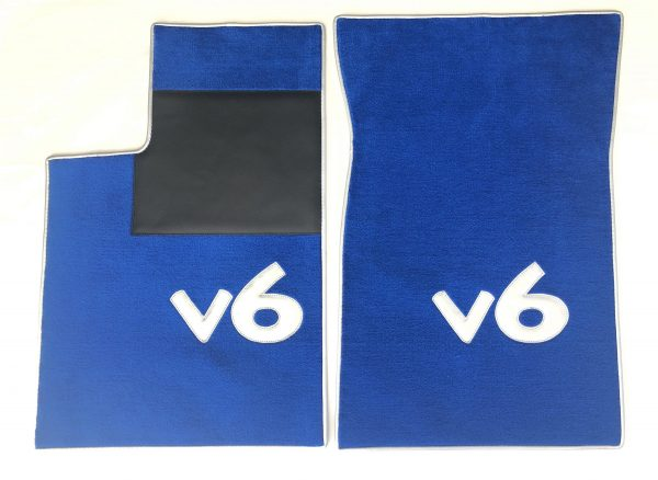 Renault Clios V6 set on carpet on carpet blue white gray