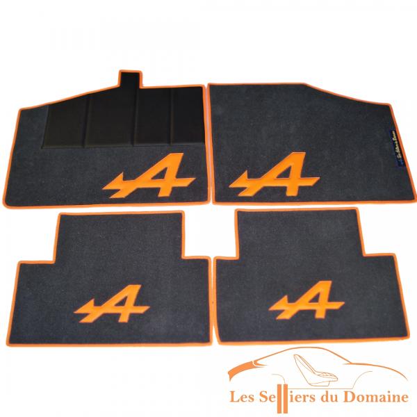 Sur tapis Alpine GTA V6 moquette gris moyen A et tour orange Alpine Renault selleries